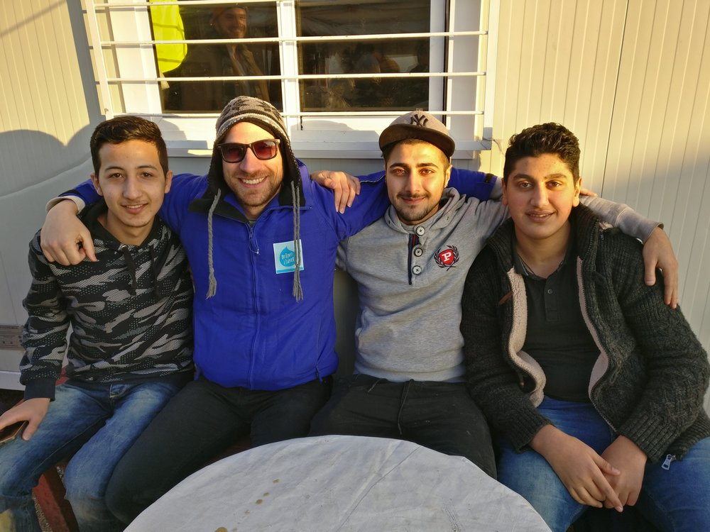 Athens, Greece - In 2016, I was a camp coordinator at Skaramagas, Greece's biggest refugee camp. Here I'm pictured with some camp residents I mentored.