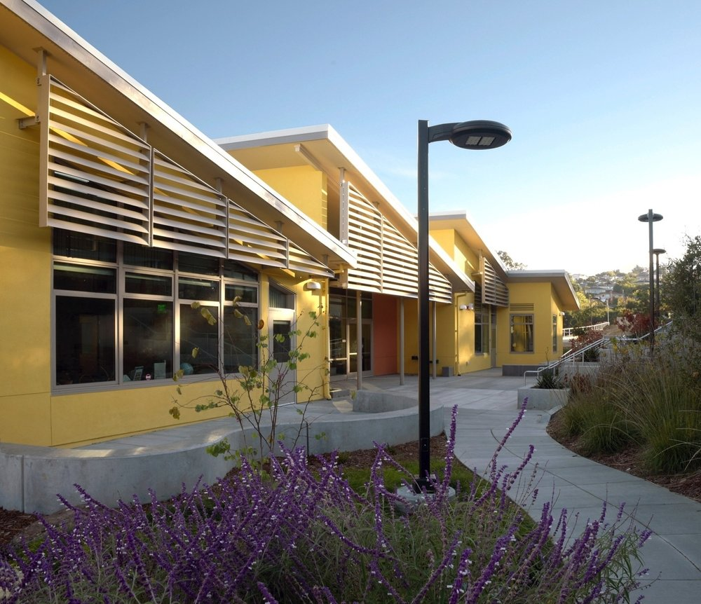 Outdoor learning areas along the uphill side of the Burlingame Intermediate School Classroom Building.