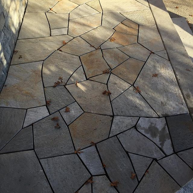 Flagstone patio with 1/2 inch cement joints. Details are key👷