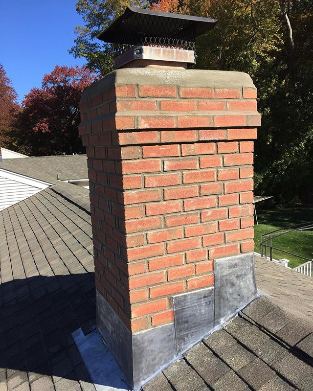 Brick chimney with new flashing and inner flues👷