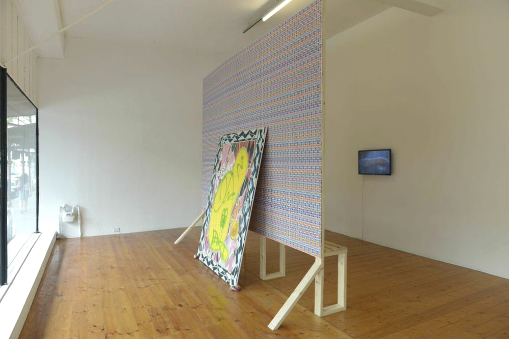 'Smokes &' install, Gertrude Contemporary, 2014. Oil on canvas, timber, wallpaper, beer cans & video