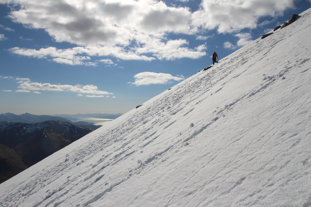 Final push to the top of Ben Nevis & seconds from disaster. I slipped and headed down this slope at speed - scary but managed to self arrest with ice axe and my arm, blood spilled - a war wound for the tourists at the summit. Photo by Johny Cook, @johnyamc
