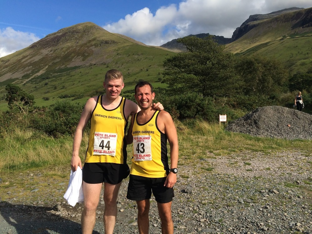 Myself & Simon post race with the conquered climbs in the background