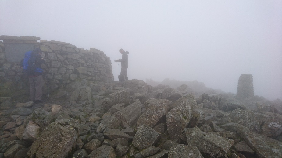 A very cloudy Scafell Pike Summit.