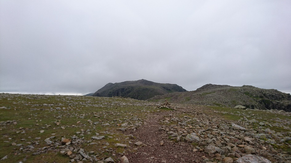 Looking back at a now cloud free Scafell Pike Summit.