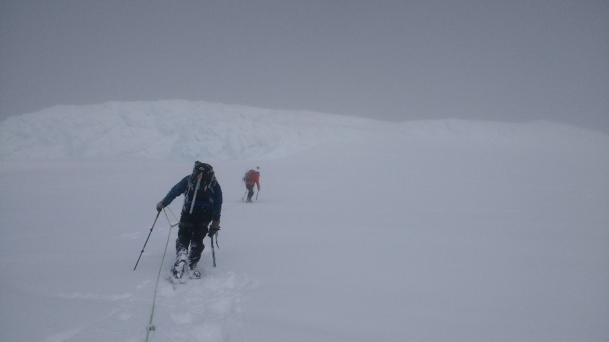Crossing a Crevasse mine field at the beginning of the ascent to the Summit.