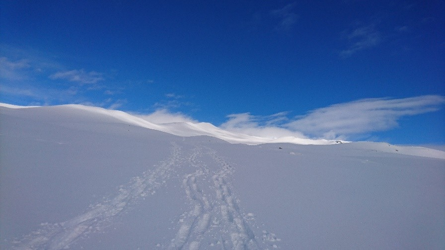 Descending the Mountain in glorious conditions, only our tracks in the fresh snow.