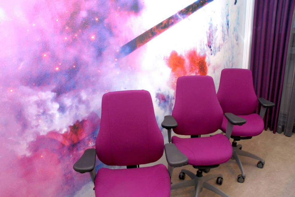 """In fhe Defence Forces Service Center we wiped the term """"army grey""""out of our vocabulary. Good example is an exploding pink tank in this wallpaper. Interior design in the Joensuu Service Center project by Anu Kankkunen,  Sisustustuuma ."""