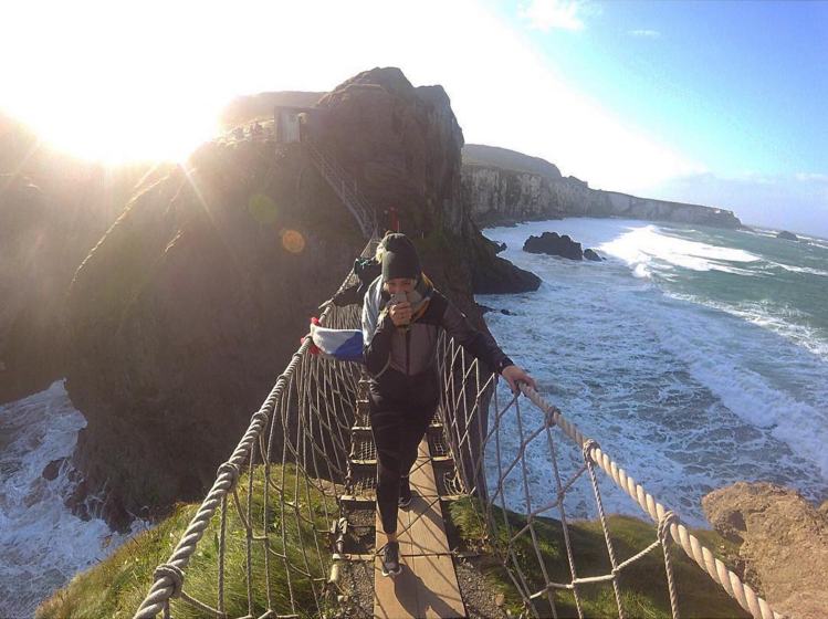 12. @alyssabonavita crossing the Carrick-a-Rede Rope Bridge in 45mph winds