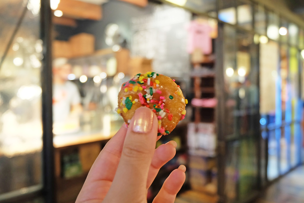 9. Doughnuttery: Doughnuttery serves fun poppable mini doughnuts in a brown paper bag, in Chelsea Market. They float along in oil in front of you before being tossed by a machine into their bin, where they are topped with sprinkles or flavorings.