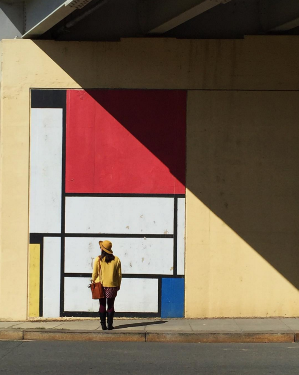 There is an old mural series on the walls of the underpass below the I-395 highway near Capital Hill in Washington, DC.  The murals pays tribute to artist Piet Mondrian and his balanced assymetry.  I couldn't resist taking a photo of my perfectly coordinated friend @jennrightmeow near that slice of light while on a walk around the Hill last fall.