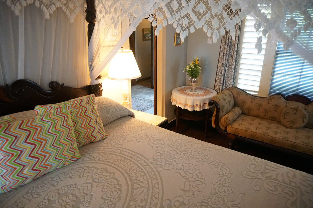 Bluefields Bay Villas Jamaica Resort Review The Travel Women master bedroom mosquito net palm tree couch