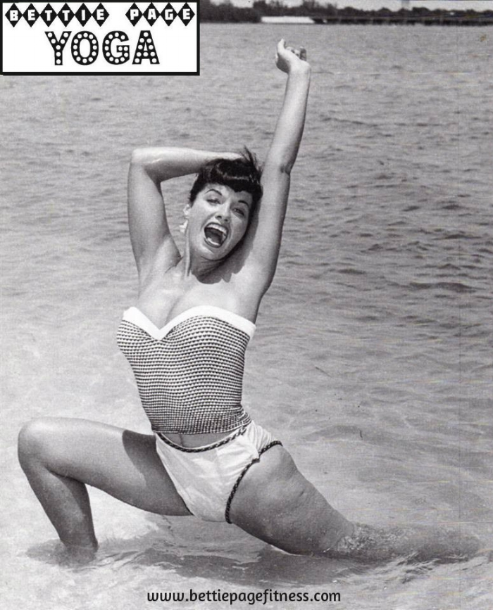 Yogi Bettie rocking Anjaneyasana (Low Lunge) at the beach - and clearly loving her body! ~Photo by Bunny Yeager~