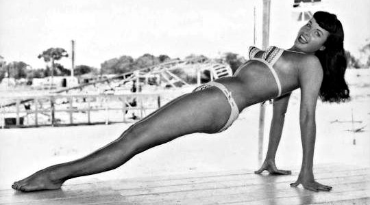 ~Bettie nailing Reverse Plank at Funland Park in Miami; photo by Bunny Yeager~