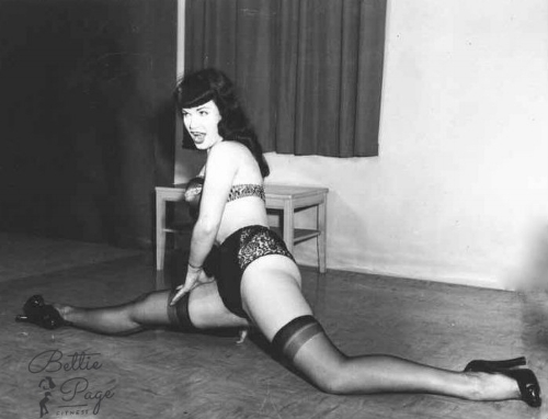 ~Bettie looking proud of her progress with the Splits! We know, we know... square the hips.~