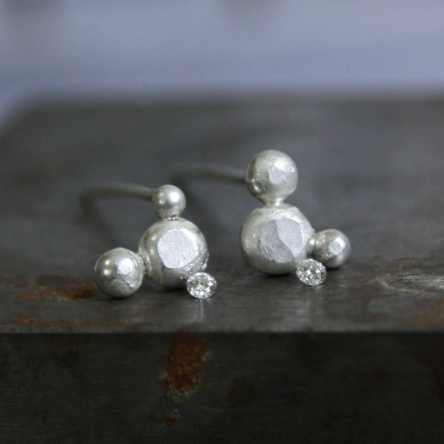Petite 2mm diamonds, ready to be flush-set.