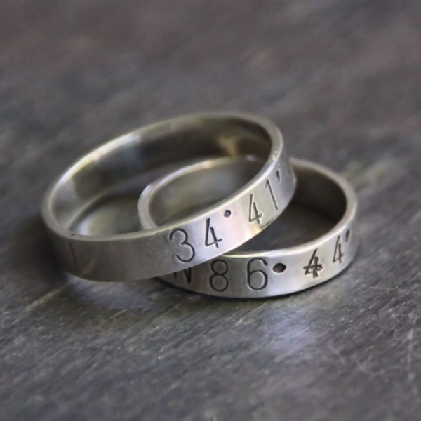 Customized coordinates rings in sterling silver.