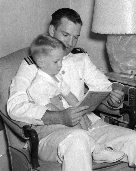 Minter reading with his son, Victor