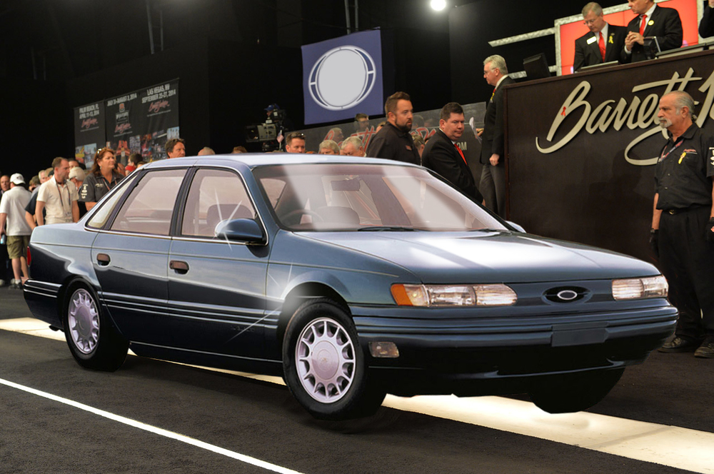 The room was electric as Joseph Andrews rolled his mint 1992 Ford Taurus onto the auction block Friday evening.