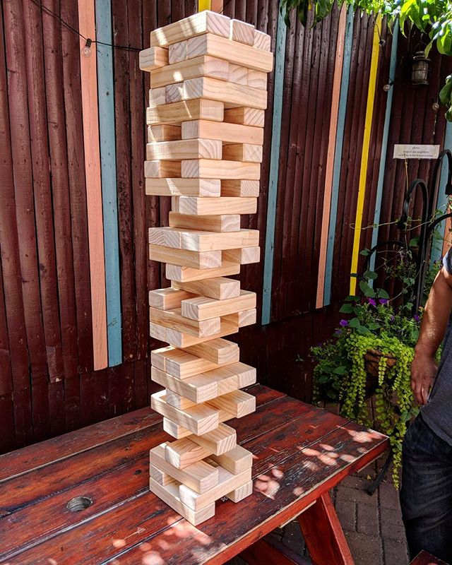 We have giant Jenga now. Come check it out. It's giant. — #divinebarbk #brooklyn #bedstuy #bushwick #newyork #bargames #jenga #thingstodoinnyc #nyc #games
