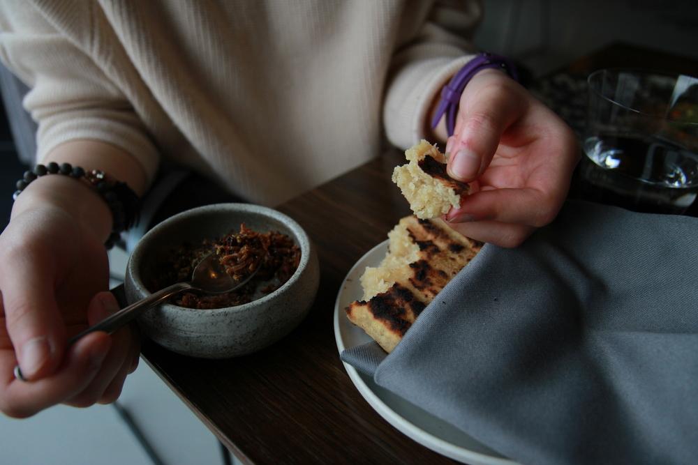 Fermented potato bread with celery root, pumpkin seed and pepper (Bánh mìược làm từ Khoai tây ủ, ăn kèm với Rễ cần tây, hạt bí ngô, tiêu và một vài loại hạt khác)
