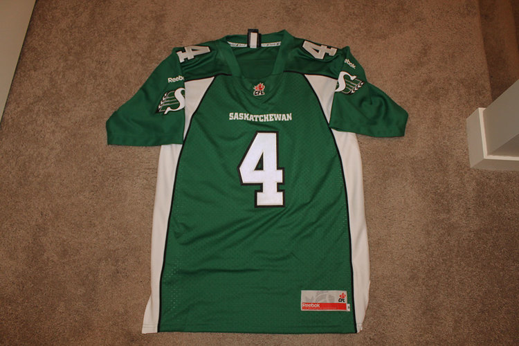 e4126fb9a82 Adult Saskatchewan Roughriders Replica Jersey (Signed in black ink w   2013  Grey Cup Champs  inscription) -  350 + free shipping within Canada