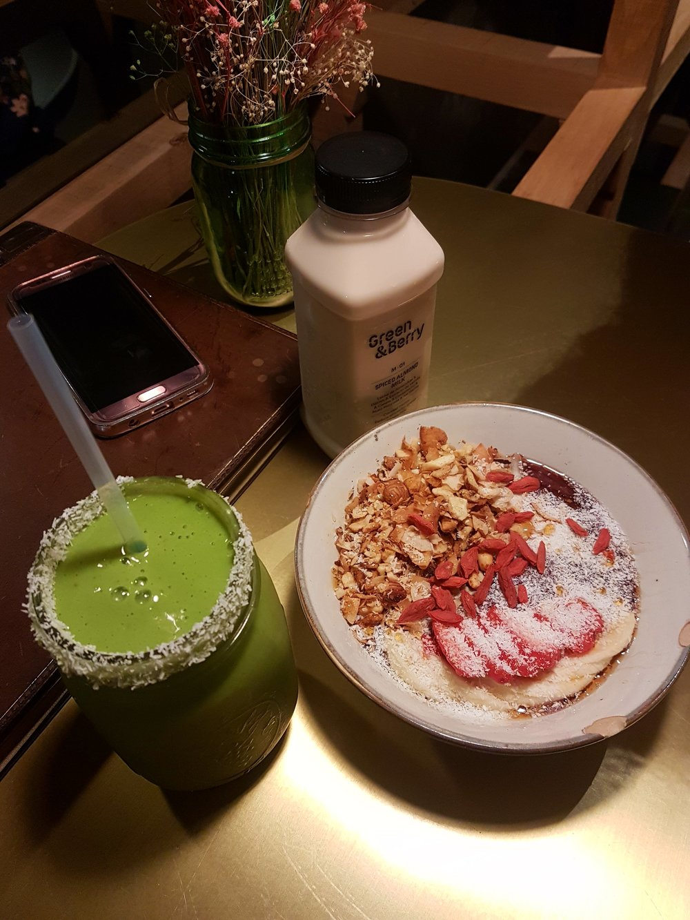 Acai berry bowl, some green smoothie and spiced almond milk