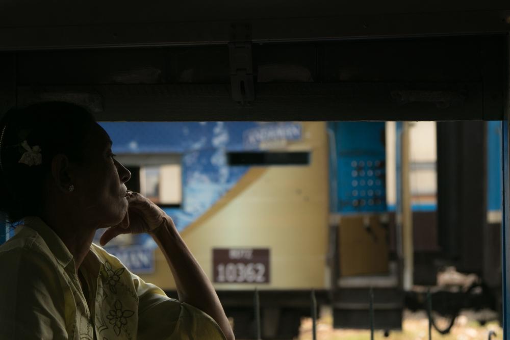 Woman looking out train window.jpg