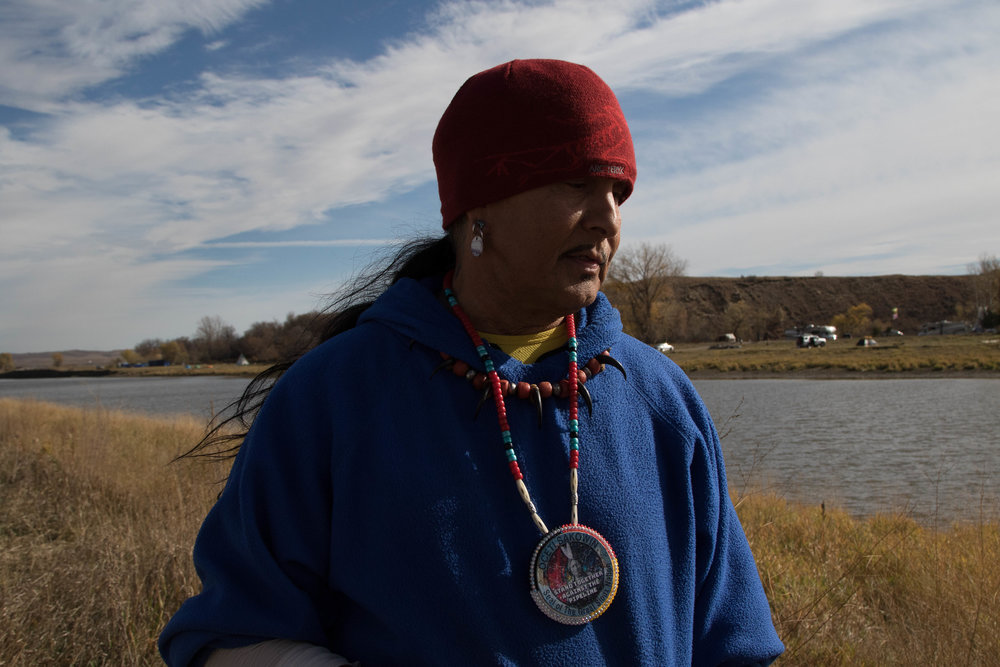 Chief David, who came from Las Vegas, Nevada, to be a part of the protests in late October, looks down over the Cannonball River. (Jackson Barnett/CU Independent)