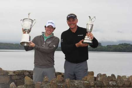 US Open champion Rory McIlroy and Open champion Darren Clarke hold their trophies aloft on the eve of the 2011 Irish Open presented by Discover Ireland at Killarney Golf & Fishing Club. Photo Fran Caffrey/ www.golffile.ie