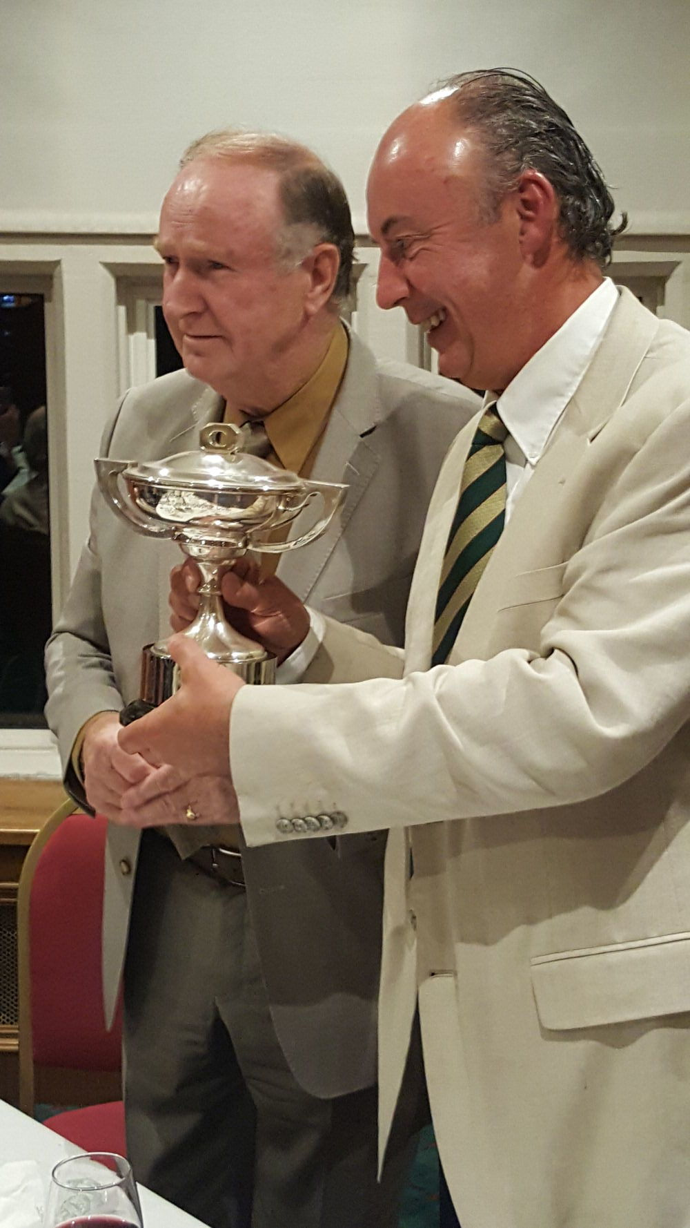 Dermot Gilleece, chairman of the IGWA, presents the Carr Cup to Dougie Heather of Portmarnock GC.