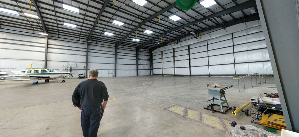 Roger, our new Director of Maintenance, inspecting the new maintenance hangar before our move.