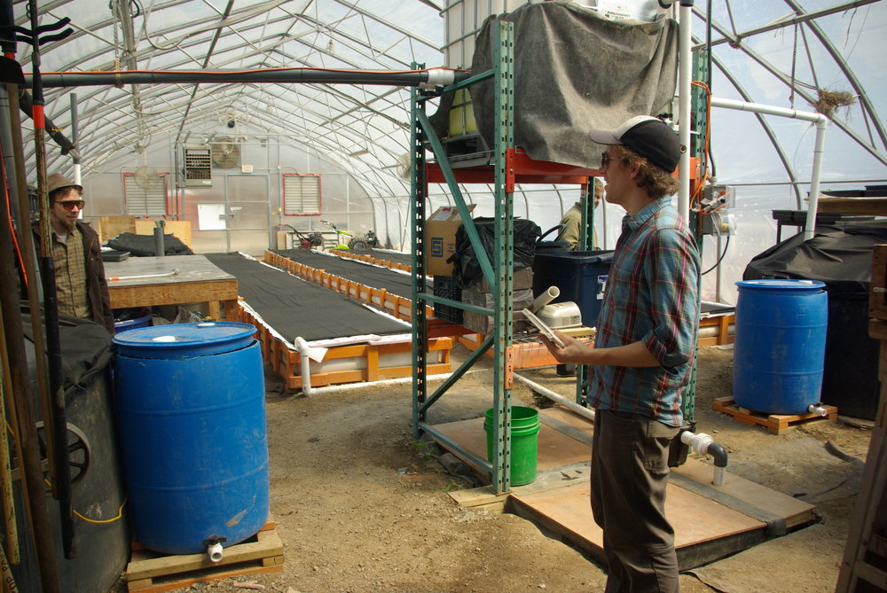 Evan Bell, WaterFarmers Chief of Operations, at Fresh City Farms during system construction.