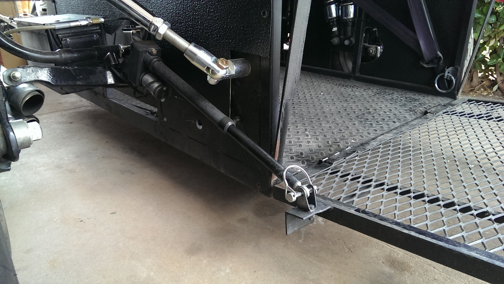 Opening and closing of the lift gate is done using this Linear actuator purchased through ebay. Removable pins are used to attach the actuator in the event the battery or actuator fail.