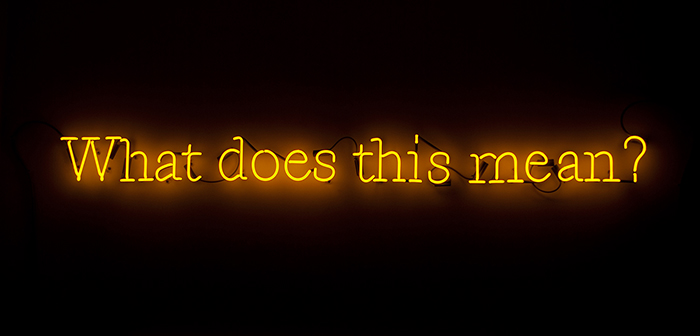 Joseph Kosuth  What Does This Mean?  Yellow neon mounted directly on wall 6 x 75 inches (15 x 190 cm)