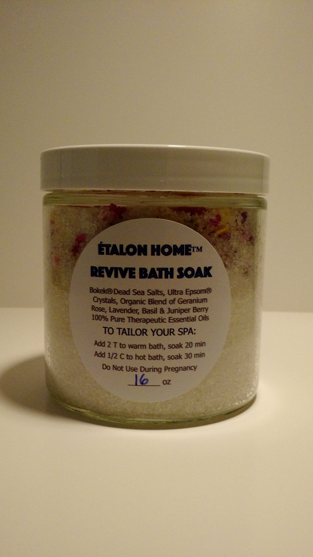 Revive Bath Soak - Originally created to treat symptoms of gout, we found our botanical blend of organic herb and floral oils provided therapeutic benefits of aromatherapy containing properties to calm, soothe, relax, balance and uplift emotions, tone, clear the mind and detoxify.  We have formulated our exclusive blend of 100% pure organic essential oils with the finest mineral salts in the world.  Bokek Dead Sea Salt® is the only Optically Clean® Dead Sea Salt available making it the cleanest, most natural unrefined Dead Sea Salt on the market. Ultra Epsom Salt® is the highest quality, pharmaceutical grade Epsom Salt available and is know for its exceptional purity and therapeutic value.Anyone using Étalon Home™ Revive Bath Soak will enjoy their time in the tub!Price:  16oz Glass Jar $24.00