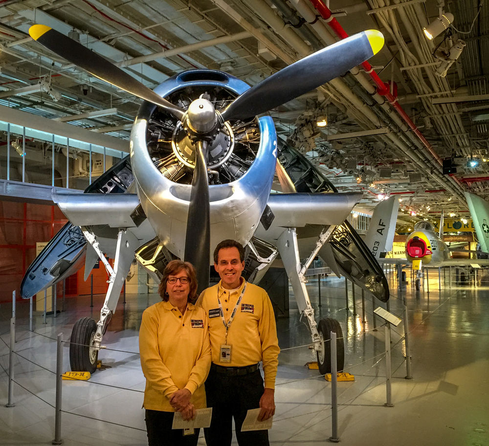 Ellen and me on the hangar deck of the USS Intrepid in front of a WWII Avenger