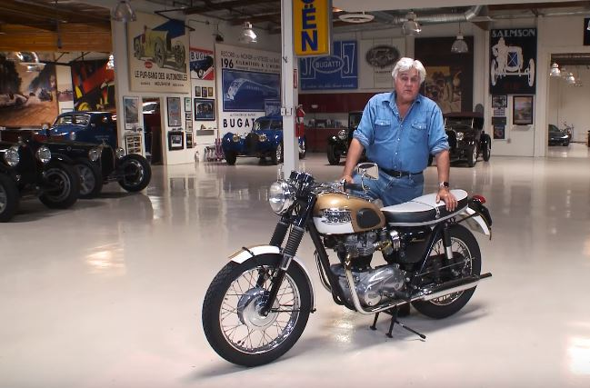 Jay Leno and his Bonnie in his famous garage