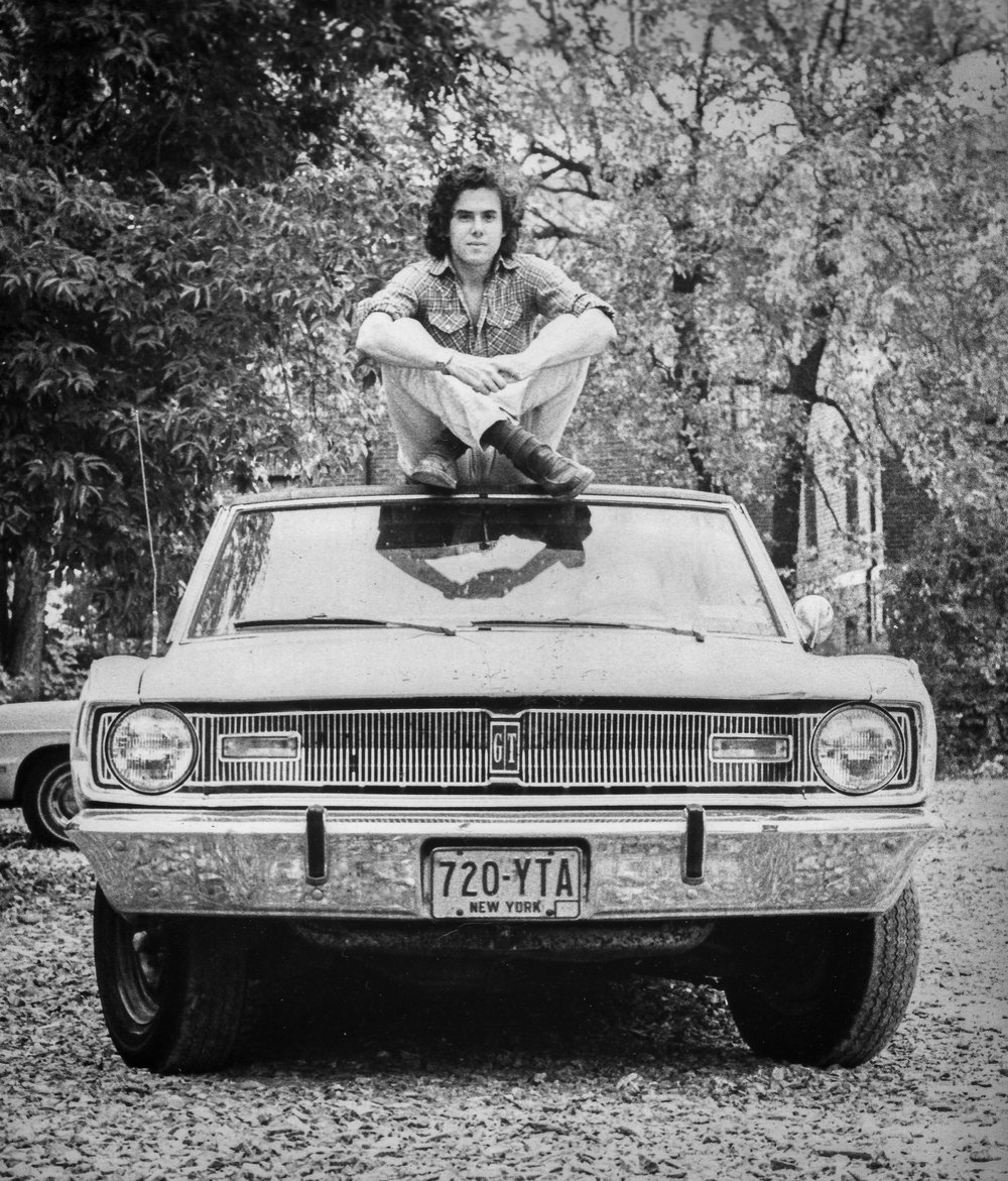 Me atop my 1967 Dodge Dart GT Two Door Sedan (still wearing white jeans)