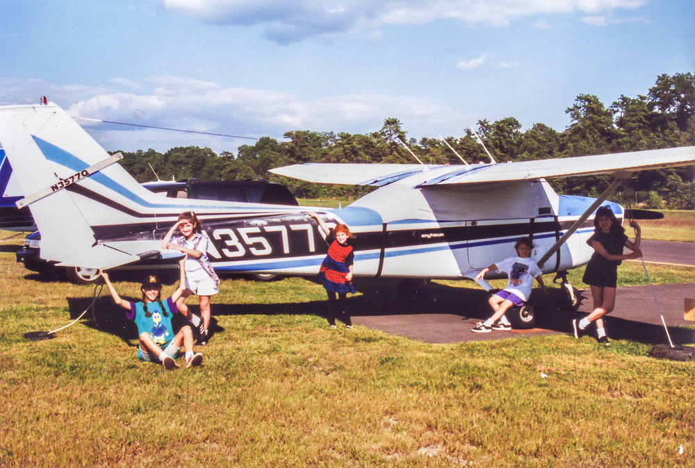 Here's my Cessna 172 Skyhawk with my daughters Amy (turquoise), and Emily (red) and some of their friends.