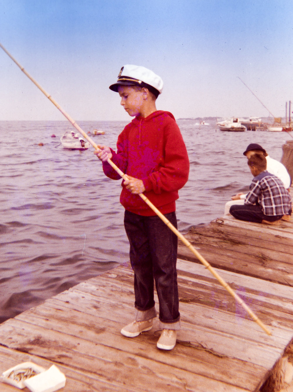 And this is me about a decade later fishing off of the same pier! This is on the Bay side of the island in the town of Ocean Beach near Houser's Hotel.