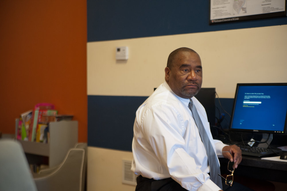 Glenn Beavers, Board VP, volunteering at LinkStL's office.  (Photo Credit: Tessa Bernhardt)