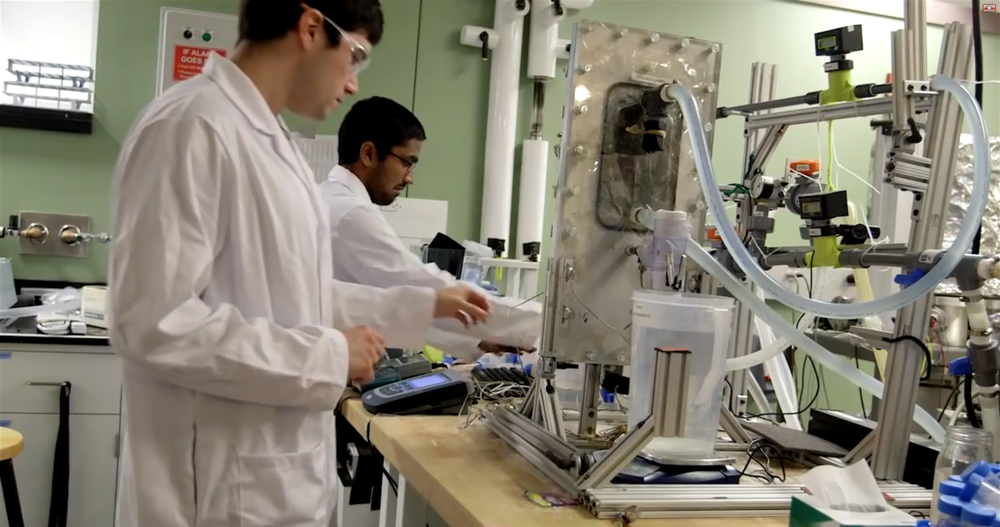 Jai and David with their membrane distillation fouling apparatus, at MIT
