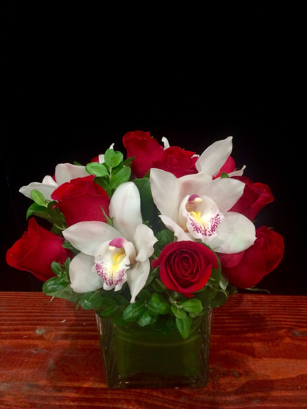 A Dozen Red Roses with White Cymbidium Orchids