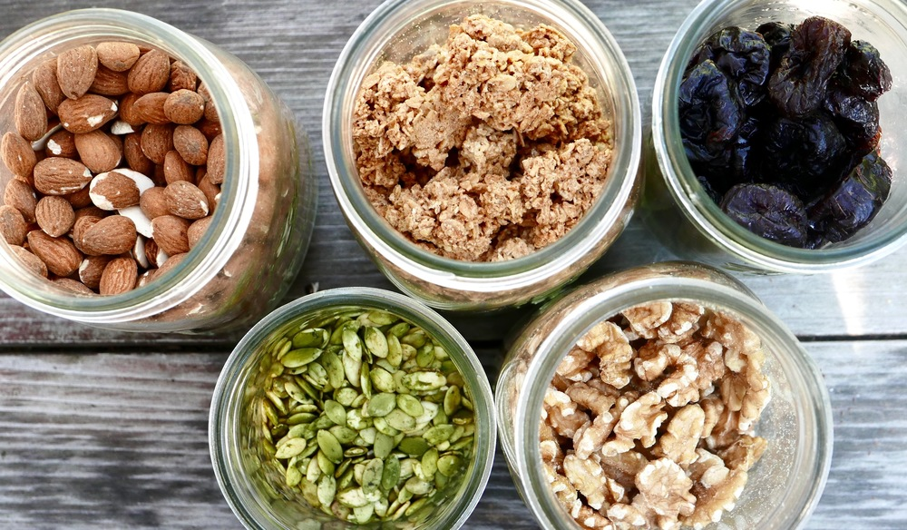 Great weekend snacks: Unsalted roasted almonds, roasted pumpkin seeds, peanut butter granola, walnuts, dried plums. Photo: Gregg McVicar