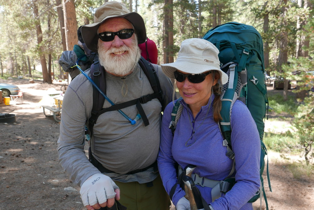 Backpackers Tom and Diane Waters head out on a 100 mile hike, part of their plan to cover the length of the John Muir Trail. Photo Credit: Gregg McVicar