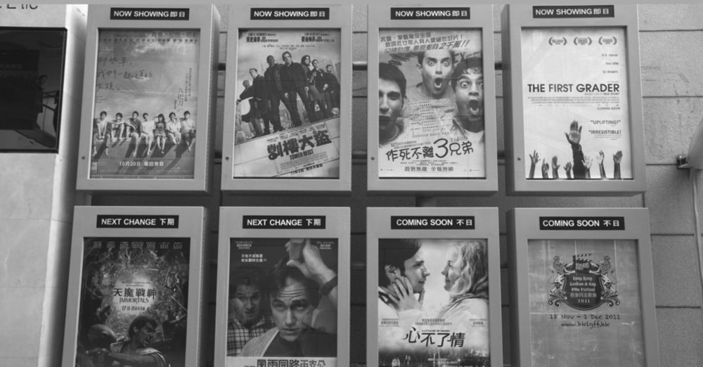 Bilingual Chinese and English movie posters at a multiplex in China. Photo: Joe Fox/Radharc Images/Alamy