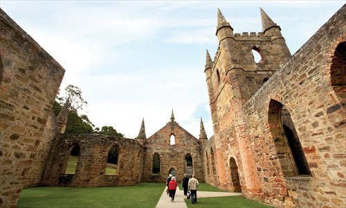 Port Arthur's Gothic church was destroyed in a bushfire over a century ago. Today, only its eerie stonework remains. Photo: Sue Murray/Tourism Tasmania