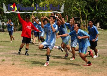 Players of the Angkor Tour Guides Association team rush to celebrate their final shootout success with winning penalty scorer Yutha Manh (unseen) at Siem Reap's Provincial Teacher Training College.