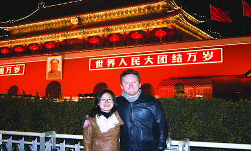 An evening stroll in downtown Beijing isn't complete without a photo featuring the iconic backdrop of the Tiananmen Rostrum.